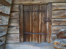 Old barn door. With a rustic wall Stock Photography