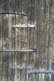 Old barn door. Wooden door with metal dress plates Stock Image