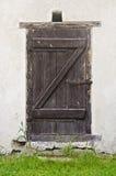 Old barn door. Old wooden barn door with rusty hasp Stock Photo