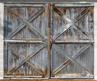 Old barn double doors. Two old weathered wooden double doors with peeling paint Stock Photography