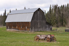 Old barn and drawn wagon Stock Photos
