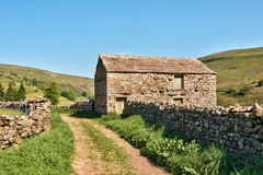 Old barn and dry stone wall Royalty Free Stock Images