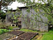 Old barn in English garden in autumn Stock Photo
