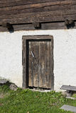 Old barn entrance with wooden small doors Stock Photo