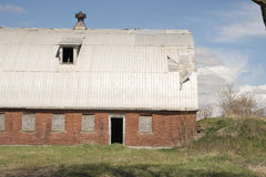 Old barn on a farm, blue sky in background. Stock Photo