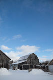 Old Barn and farm buildings on a sunny winter day with snow land Stock Photography