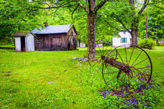 Old barn and farm equipment at  Millbrook Village, at Delaware W Royalty Free Stock Photo
