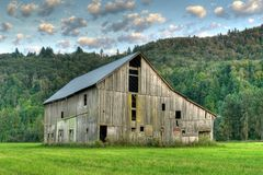 Old Barn Farm HDR. Heritage barn shot with high dynamic range Royalty Free Stock Images