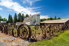 Old barn with fence made from old steel wheels Stock Photos