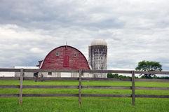 Old barn and fence, New Jersey. Old dairy barn fence and silo Stock Images