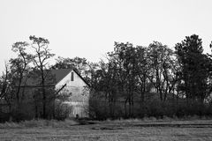 Old barn by field. Stock Photo