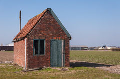 Old barn in the field. Dilapidated old barn in a Dutch landscape Royalty Free Stock Photo