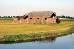 Old barn on a field. Royalty Free Stock Photography