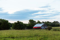 Old barn in a field Stock Photography
