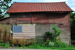 Old barn with flag Stock Photos