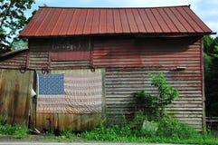 Old barn with flag stock photos