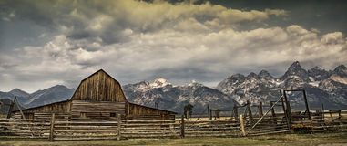 Old barn. With Grand Teton mountain range in the Background Royalty Free Stock Photography