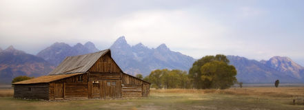 Old Barn with Grand Tetons in background Stock Photo