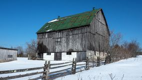 Old Barn. With green roof top Stock Image