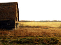 Old Barn after Harvest. An abandoned barn near a harvested field.  Near the town of Birtle, Manitoba Stock Photography