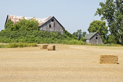 Old barn with hay bales Stock Photos