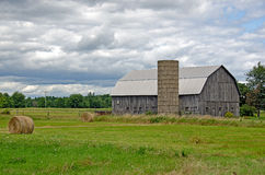 Old barn with hay bales Royalty Free Stock Photography