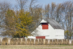 Old Barn and Hay Rolls Royalty Free Stock Images