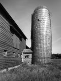 Old barn with leaning silo Stock Photos