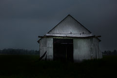 Old barn in Mirabel,Québec. Old barn alone in the field Royalty Free Stock Photography