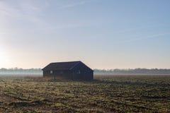 Old barn in misty farmland. Achterhoek. Gelderland. The Netherla Stock Photography
