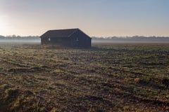 Old barn in misty farmland. Achterhoek. Gelderland. The Netherla Royalty Free Stock Photo