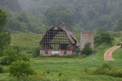 Old Barn. Misty Morning and a unique old barn that stands the test of time Stock Photography