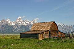 Old Barn near mountains. Old barn with Grand Tetons behind Royalty Free Stock Image