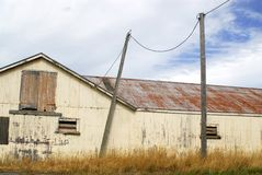 Old barn in New Zealand. A delapidated and rusty old barn on a sheep farm outside Wellington, New Zealand Stock Photos