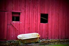Old barn and old tub. An old barn and old tub were on the road in asmall town in North Carolina Royalty Free Stock Images