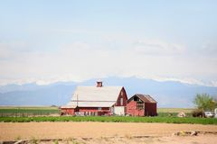 Old barn overlooking the mountains Stock Images