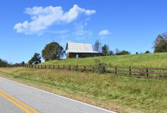 Old Barn and Pasture on the Highway. An old barn and pasture area on the side of a highway, a beautiful and peaceful landscape stock photos