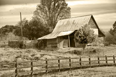 Old Barn/Pasture/Sepia. An old barn with fence with a sepia tint Stock Photos