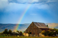 Old barn and rainbow. Stock Image