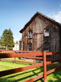 old barn with red fence Royalty Free Stock Image