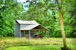 Old Barn and Red Tractor Stock Images