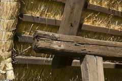 Old barn roof contruction in wood and dried grass Royalty Free Stock Image