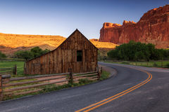Old barn and rural road. Royalty Free Stock Photos