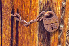Old barn rusty lock on the door Royalty Free Stock Photo