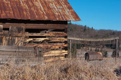 Old Barn with Rusty Manure Bucket Stock Image