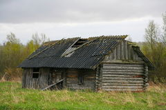 Old barn scene in western Russia.  rustic old farm building. old rustic barn. Pskov oblast, Northwest part of Russia, Europe. Aging cart near wooden barn. View Royalty Free Stock Photos