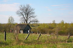 Old barn scene in western Russia.  rustic old farm building. old rustic barn. Pskov oblast, Northwest part of Russia, Europe. Aging cart near wooden barn. View Royalty Free Stock Images