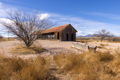Old Barn with Scrub Brush and Blue Sky Stock Images