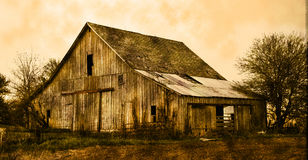 Old Barn in sepia. Old farm barn near a field in sepia royalty free stock photography
