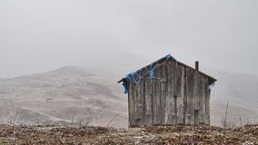 Old barn or shepherd`s hut in the Caucasus mountains stock images